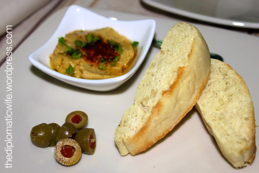 Hummus with toasted focaccia and olives