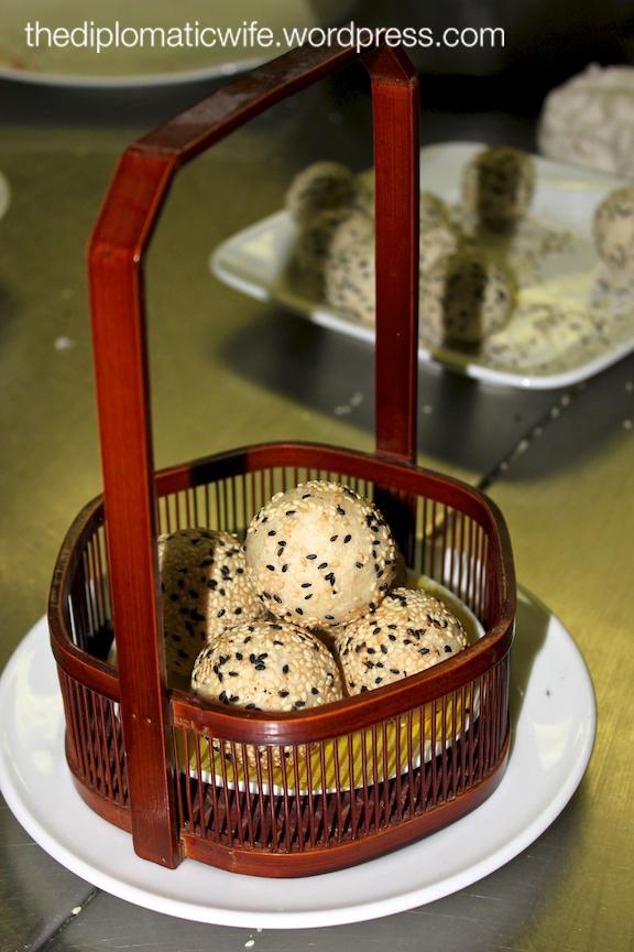Crispy black and white sesame ball with peanut paste & macadamia nut