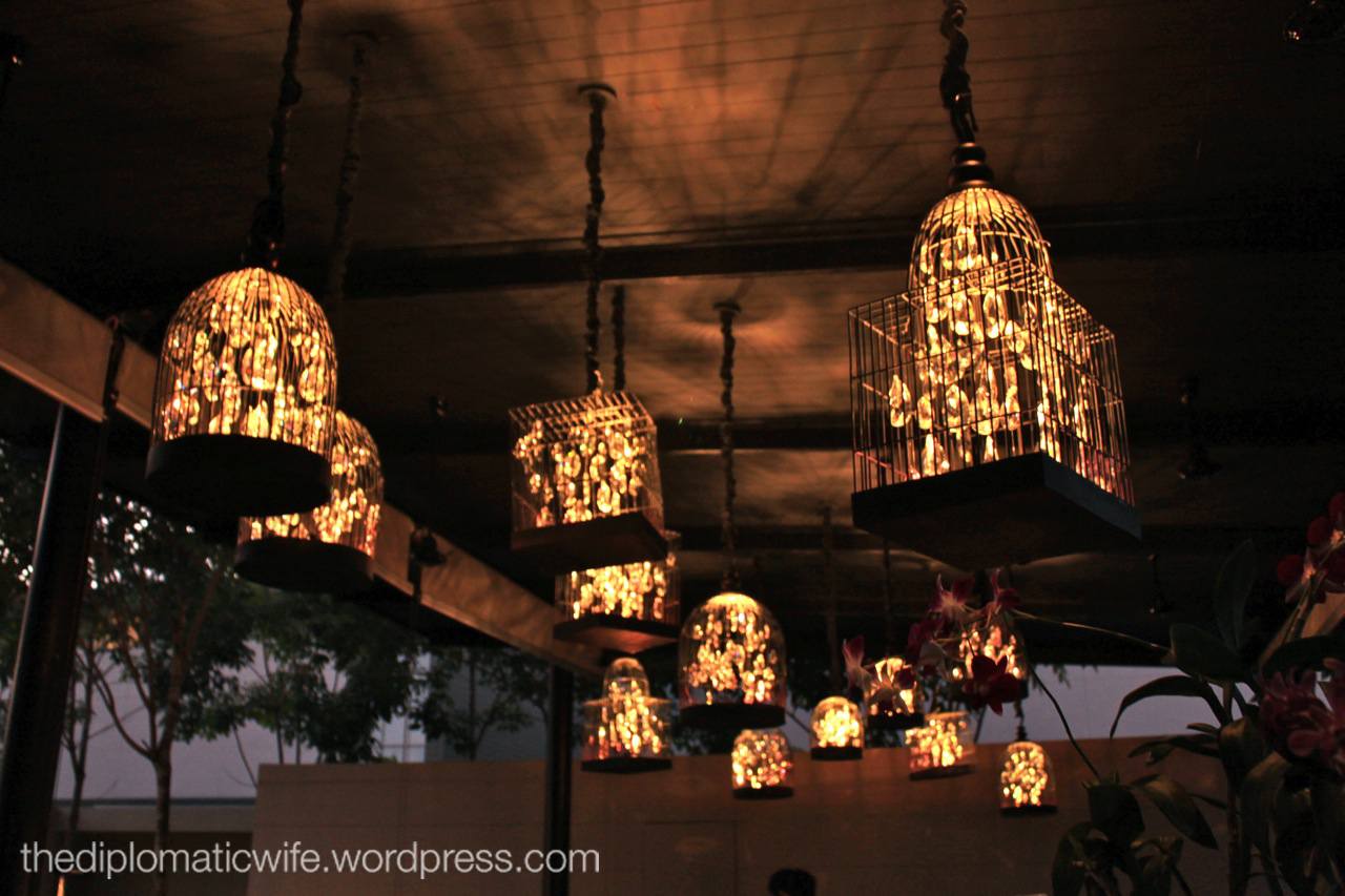 Bird-cage encased crystal chandeliers at the sala phuket lobby
